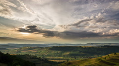 Transylvania hills patchwork fields dramatic sky 4K - stock footage