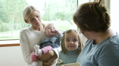 Health Visitor Talking To Mother With Young Children Stock Footage