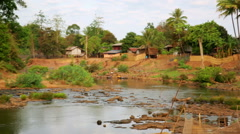 TAD LO, LAOS - MARCH 2014: Women washing clothes at river, Stock Footage