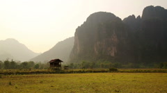 Backpacker heaven, Vang Vieng with limestone mountains, Laos Stock Footage
