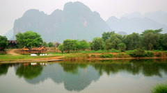 Morning at limestone mountains of Vang Vieng village, Laos Stock Footage