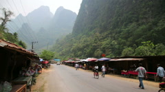 VANG VIENG, LAOS - APRIL 2014: local market on valley Stock Footage