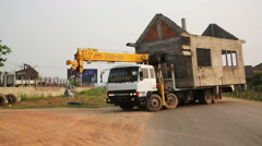 VANG VIENG, LAOS - APRIL 2014: carrying instant house Stock Footage