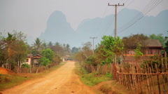 Daily life of Vang Vieng village with limestone mountains, Laos Stock Footage