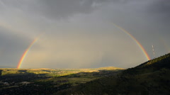 Full Rainbow Over Denver Area Stock Footage