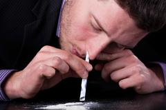 businessman addicted to drugs - stock photo