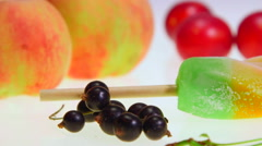 Dolly: Ice lolly with fresh fruit and berries close-up Stock Footage