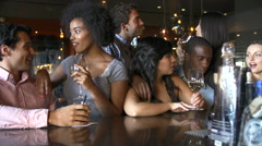 Group Of Friends Enjoying Drink At Bar Together Stock Footage