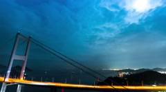 Time lapse boats travelling underneath giant bridges at night Stock Footage