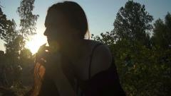 Girl at sunset Stock Footage
