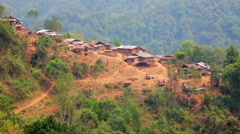 Zoom - Akha tribe village on mountain, Pongsali, Laos Stock Footage