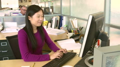 Woman Working At Computer In Modern Office - stock footage