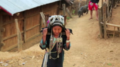 indigenous tribal native Akha woman carry water in bamboo stick - stock footage
