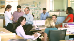 Interior Of Busy Design Agency With Staff Working Stock Footage