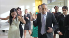 Businessmen And Businesswomen Dancing In Office Lobby Stock Footage