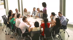 Businesswoman Addressing Meeting Around Boardroom Table Stock Footage