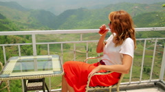 Single attractive woman drinking tea on magnificent mountain view Stock Footage