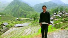SAPA, VIETNAM - MAY 2014: native Akha man posing Stock Footage