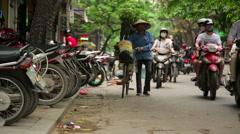 HANOI, VIETNAM - MAY 2014: everyday life on street Stock Footage