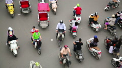 Stock Video Footage of HANOI, VIETNAM - MAY 2014: crazy motorbike traffics