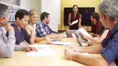 Female Boss Addressing Meeting Around Boardroom Table Stock Footage