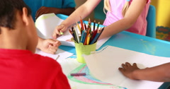 Preschool class drawing at table in classroom Stock Footage