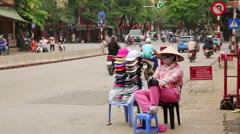HANOI, VIETNAM - MAY 2014: street seller woman Stock Footage