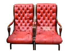 Two isolated red armchairs. Stock Photos