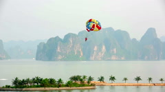Parasailing over limestone mountain islands, Halong Bay, Vietnam Stock Footage