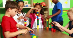 Cute classmates playing with building blocks Stock Footage
