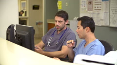 Medical Staff Working At Busy Nurses Station - stock footage