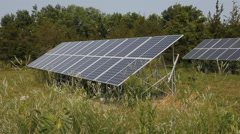 Solar arrays in rural area. Side view. Stock Footage