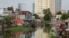 Ho Chi Minh City slums by river, Saigon, Vietnam Stock Footage