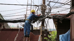 Electrician fixing, repairing messy electric cables in hanoi slums, vietnam Stock Footage