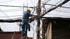 electrician fixing, repairing messy electric cables in hanoi slums, vietnam - stock footage