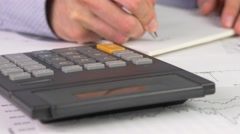 4K Calculator And Taking Notes Stock Footage