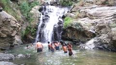 People enjoying and bathing in Ravana Falls in Ella. Stock Footage