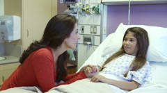 Mother And Daughter Talking With Male Nurse in Hospital Room Stock Footage