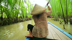 Stock Video Footage of Rower Paddle Canoe at Majestic Gorgeous Mekong River, Vietnam