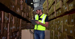 Warehouse worker checking his list Stock Footage