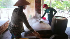MEKONG DELTA, VIETNAM - MAY 2014: noodle makers Stock Footage