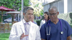 Stock Video Footage of Medical Team Having Discussion Outdoors