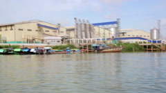 Floating market slums near factory, mekong delta, vietnam Stock Footage