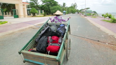 Wheelbarrow hand cart carrier porter in Vietnam Stock Footage