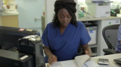 Medical Staff Working At Nurses Station Stock Footage