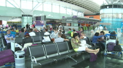 Passengers with baggage are waiting for your flight in the airport Stock Footage