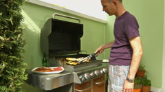 Father at barbecue grill Stock Footage