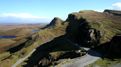 Vehicle Scottish highland road over Trotternish Ridge Skye Scotland Stock Footage