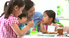 Asian Family Having Breakfast Together In Kitchen - stock footage