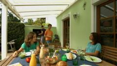 Family enjyoing barbecue Stock Footage